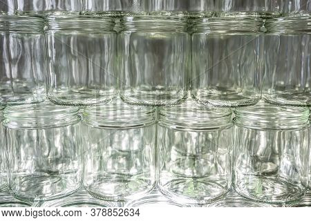 Many Glass Jar Empty Glasses Row For Jam Honey With Lid Caps Abstract Background Bokeh