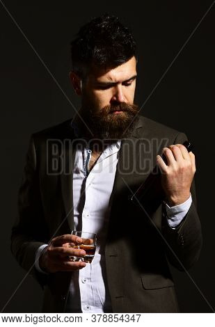 Sommelier With Beard Tasting Alcohol. Businessman With Confident Face
