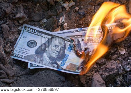 Three Hundred Dollar Bills Burn In The Fire. Concept: Recession, Crisis, Confusion, Unhappiness, Pov