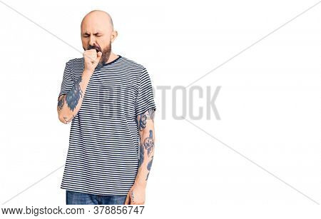 Young handsome man wearing casual clothes feeling unwell and coughing as symptom for cold or bronchitis. health care concept.