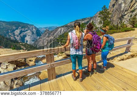 Yosemite, California, United States - July 24, 2019: People Looking Panorama From Of Nevada Fall Wat