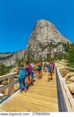 Yosemite, California, United States - July 24, 2019: Liberty Cap Vertical View From Nevada Fall Brid
