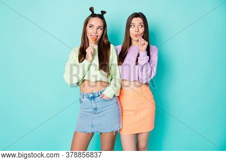 Photo Of Two Pretty Funny Lady Hold Lollipop Hands Good Mood Sweets Addicted Licking Tasty Candy Wea