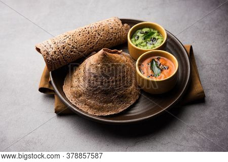 Ragi Dosa made Using Batter Of finger Millet Is A Healthy Indian Breakfast Served With Chutney