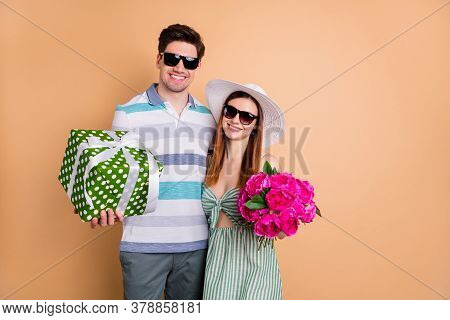 Photo Of Pretty Attractive Lady Handsome Guy Couple Hold Fresh Bunch Flowers Big Gift Box Hugging Bi