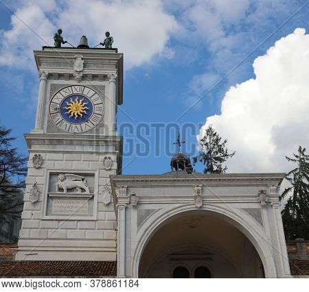 Ancient Clock Tower In Udine City In The Main Square Called Piazza Liberta In Northern Italy