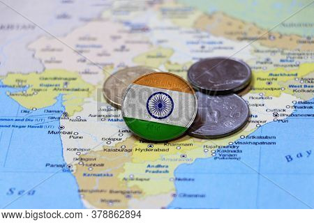 India Flag On The Coin And Heap Heap Of Rupee Indian Money Put On The India Map. Concept Of Money Fi