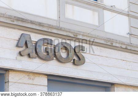 Carrara, Italy - July 10, 2020 - The Metal Sign Of The Agos Company. Agos Is An Italian Financial Co