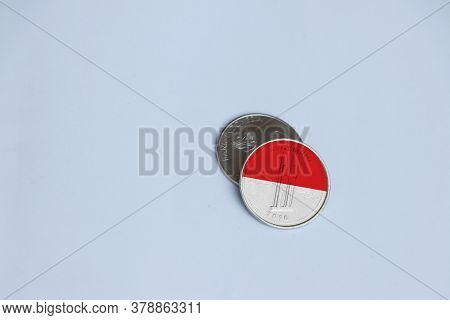 Indonesia Flag On The Coin Of One Thousand Rupiah On The White Background. Concept Of Finance Or Cur
