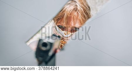 Female Gangster Bandit With Headscarf Over Her Face Holding Gun