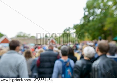 Blurred Crowd Of People Gathering And Watching Something In Suburban City In Sweden