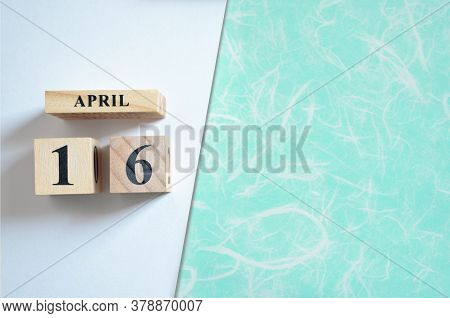 April 16, Empty White - Green Background With Number Cube.