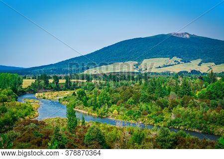 Panoramic View Over Tongariro River Delta With Magnificent Mountains At The Horizon.