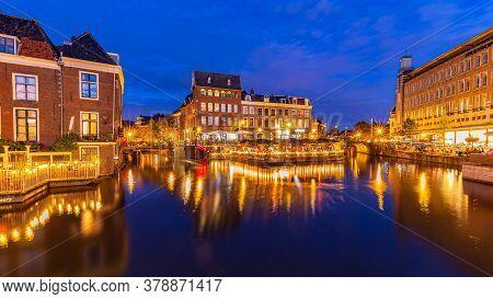 Leiden, Netherlands - July 23, 2020: Cityscape Leiden With Catharinabridge, Waterways, And Hartebrug