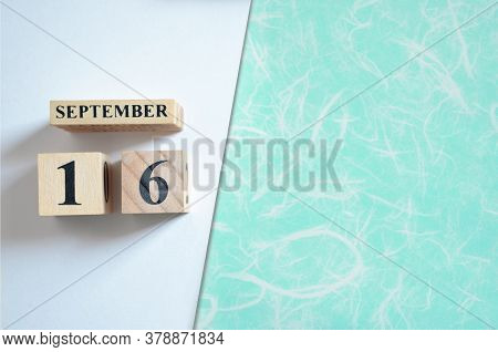 September 16, Empty White - Green Background Wih Number Cube.