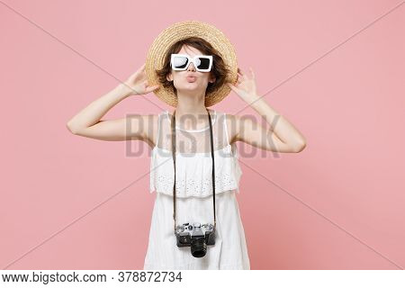 Cute Young Tourist Woman In Summer Dress Hat Sunglasses With Photo Camera Isolated On Pink Backgroun
