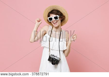 Funny Young Tourist Woman In Summer Dress Hat Sunglasses With Photo Camera Isolated On Pink Backgrou