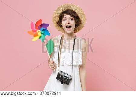 Excited Young Tourist Woman In Summer Dress Hat With Photo Camera Isolated On Pink Wall Background I