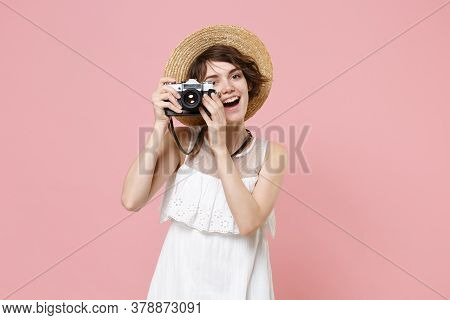 Cheerful Young Tourist Woman In Summer Dress Hat Isolated On Pink Background. Traveling Abroad To Tr
