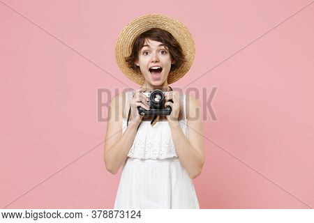 Excited Young Tourist Woman In Summer Dress Hat Isolated On Pink Background. Traveling Abroad To Tra