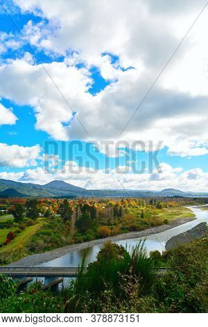 Colourful Autumn Landscape Of Tongariro River Delta. Sight Of Lake Taupo And Magnificent Mountains I