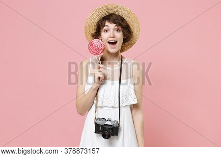 Excited Young Tourist Woman In Summer Dress Hat With Photo Camera Isolated On Pink Background In Stu