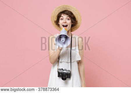 Excited Young Tourist Woman In Summer White Dress Hat With Photo Camera Isolated On Pink Background.