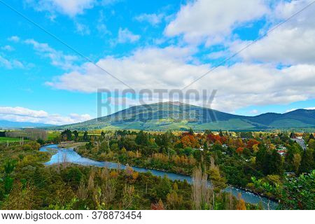Colourful Autumn Landscape Of Tongariro River Delta Down To Lake Taupo With Magnificent Mountains At