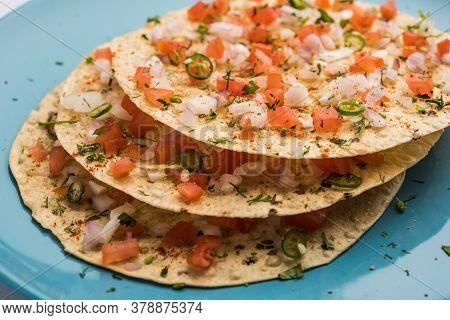 Masala Papad Or Spicy Papadum Is An Indian Or Asian Vegetarian Crispy Food, Starter In Restaurants
