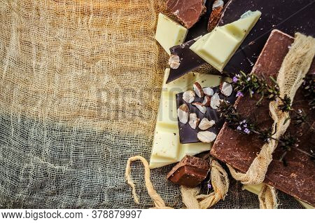 Black, White, Milk Chocolate Pieces. Many Types Of Chocolate