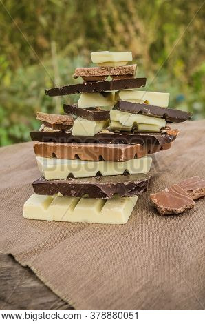 Assorted Chocolate On Rustic Wooden Background