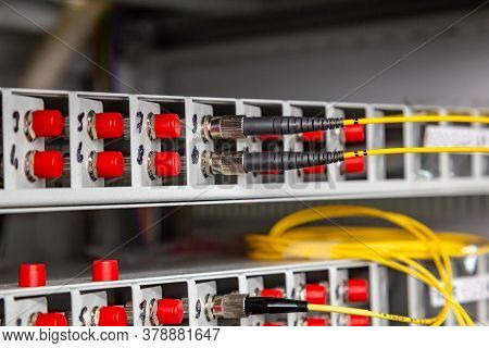 Yellow-black Fiber Optic Cables Are Inserted Into The Switch. Close-up. Horizontal Orientation.