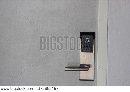 Smart Card Door Key Lock System In Hotel. Hotel Electronic Lock On Wooden Door. Entrance Door With E