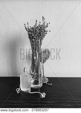 A Glass Vase With Lavender And A Decorative Heart Accentuates The Matte Perfume Bottle, Creating An