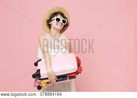 Smiling Tourist Woman In Summer Dress Hat Sunglasses Isolated On Pink Background. Female Traveling A
