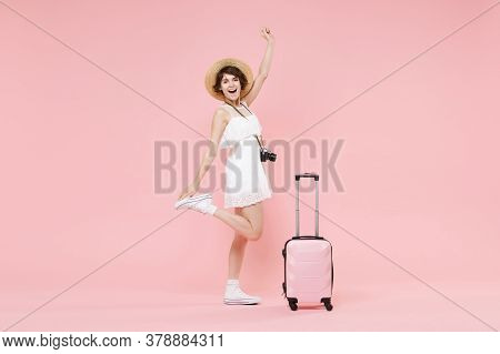 Funny Tourist Girl In Summer Dress Hat With Photo Camera Suitcase Isolated On Pink Background. Femal