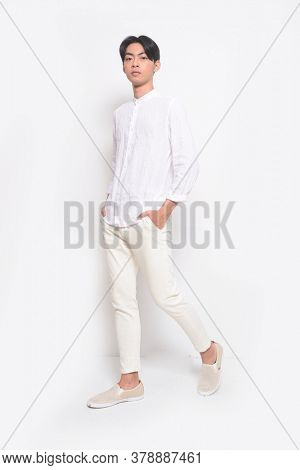 Full body Young handsome man with wearing casual t-shirt with white jeans pants runway in studio