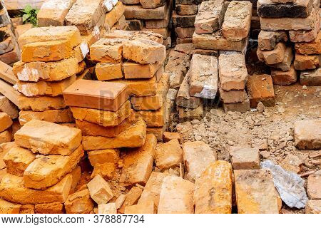 Pile Of Red Bricks At A Construction Site In The City. Repair, Industrial Brickwork Parts, Construct