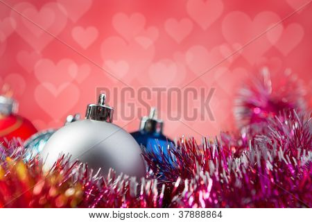 Christmas balls isolated on red background