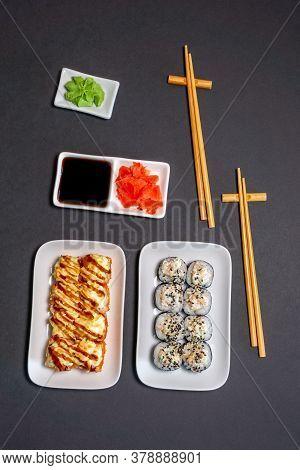 Sushi Rolly, Maki, Nigiri Set Server For Two On Black Stone On Dark Background. Top View Flat Lay