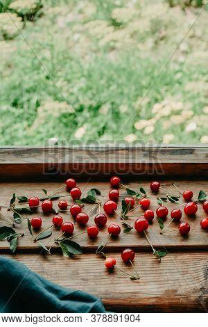 Ripe Cherries On A Wooden Windowsill. Cottagecore Aesthetics. Rustic, Vintage Style Harvest Season C