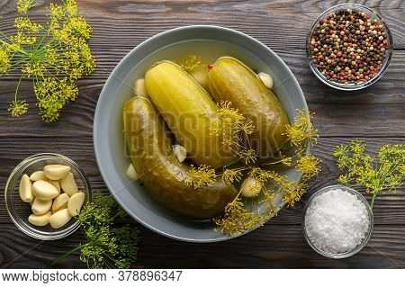 Healthy Fermented Food. Fermented Cucumbers In A Plate, Garlic, Dill And Peppers In Bowls On A Dark