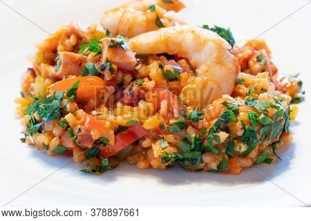 Creole Jambalaya On A White Plate, A Typical Cajun Cuisine Dish Rom New Orleans, Louisiana With Shri