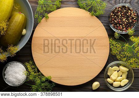 Healthy Fermented Vegan Food. Empty Cutting Board, Fermented Cucumbers In A Plate And On A Wooden Ba