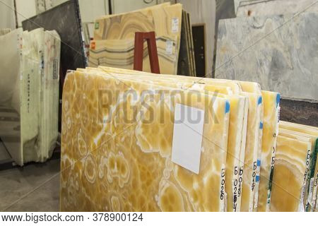 Colorful Marble Slabs In Store Show Room. Onyx Slabs Are Prepared For Sale In Store Yard