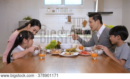 Family Concept. The Family Is Eating Together Happily In The House. 4k Resolution.