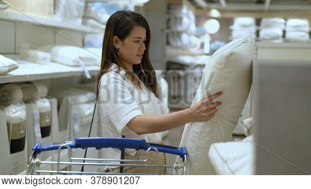 Shopping Concepts. Asian Women Are Choosing To Look At Pillows In The Bedding Department. 4k Resolut