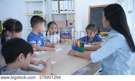 Educational Concepts. Kindergarten Children Are Presenting To Teachers In The Classroom. 4k Resoluti