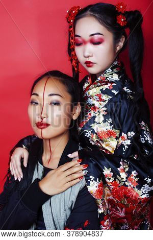 Two Pretty Geisha Girls Friends: Modern Asian Woman And Traditional Wearing Kimono Posing Cheerful O