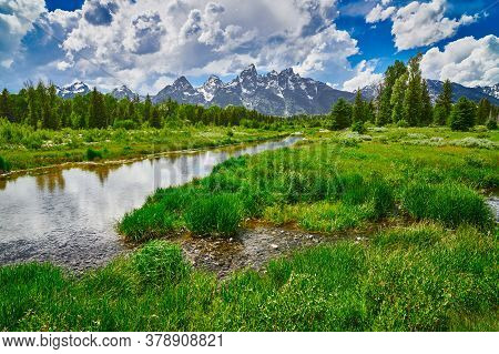 Snake River With The Grand Teton Mountains At Grand Teton National Park.